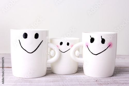 Family concept white mugs.Mother,father,baby.