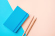 Writing Notepad Wood Pencils on Contrast Blue Peach Pink Pastel Color Background Combination. Business Education Routine Organization Planning Concept. Elegant Style Copy Space