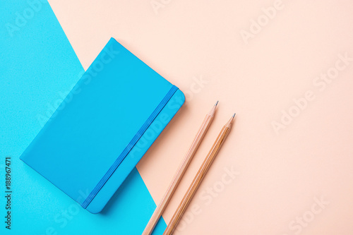 Fotografie, Obraz  Writing Notepad Wood Pencils on Contrast Blue Peach Pink Pastel Color Background Combination