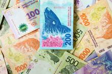 Close-up Of Bills Of 200 Argen...