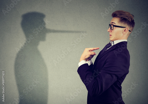 Fotografering  Man pointing at himself while lying