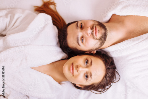 Keuken foto achterwand Spa Beautiful couple relaxing in spa center lying on massage table