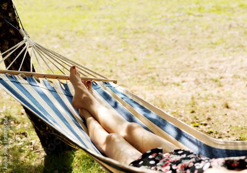 Plakát  Woman relaxing in the hammock