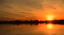Beautiful Sunset On The River Bank./The Sun Is Setting On The Banks Of The River. Create A Beautiful Natural Light.