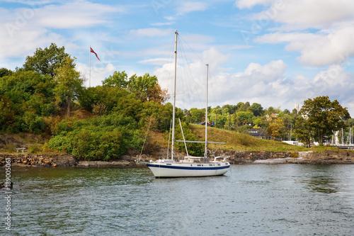 Photo  Boat in small harbor