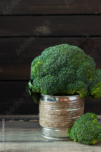 Fotografia  Broccoli cabbage on a wooden rustic background