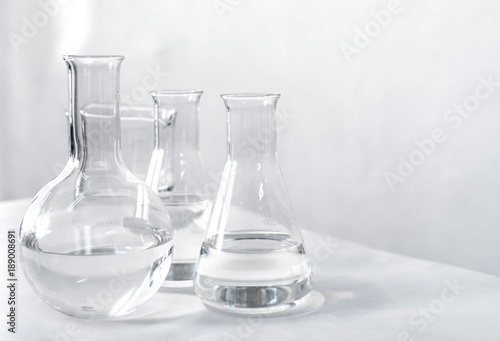 Science laboratory chemical beaker, Erlenmeyer and round flask lab glassware equipment Wallpaper Mural