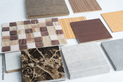 Photo  samples of material, wood , color ,ceramic , on wooden table on white background