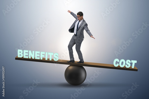 Fototapeta Businessman balancing between cost and benefit in business conce obraz