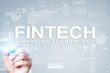 Fintech. Financial technology text on virtual screen. Business, internet and technology concept.?
