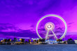 canvas print picture - Spinning ferris wheel at sunrise blue hour in Rimini, Italy. Long exposure abstract image