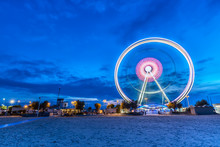 Spinning Ferris Wheel At Sunrise Blue Hour In Rimini, Italy. Long Exposure Abstract Image
