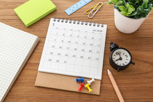 Calendar With Clock On Table