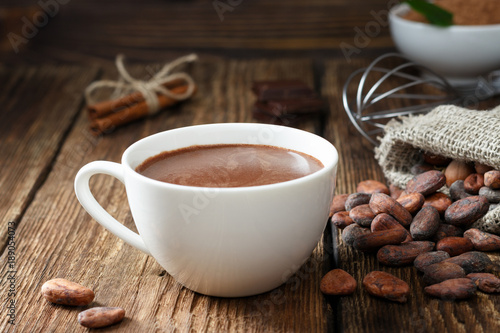 Spoed Foto op Canvas Chocolade Hot chocolate in the cup on the wooden table.