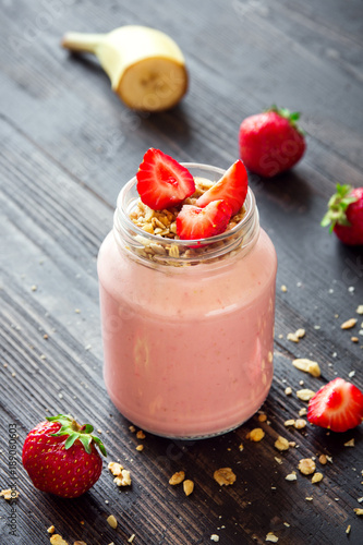 Canvas Print Strawberry and banana smoothie with granola