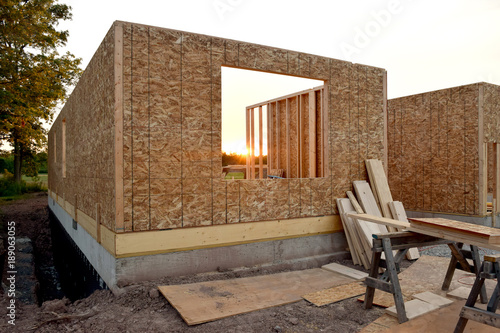 Foto op Canvas Tuin New Home House Construction Framing Lumber Builders Carpentry Craftsman