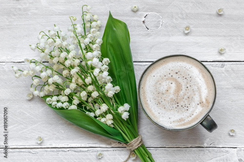 Wall Murals Lily of the valley spring lily of the valley flowers bouquet with cup of coffee with milk