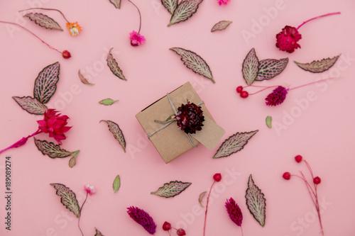 Valokuvatapetti handmade gift box and plant leaves and flowers