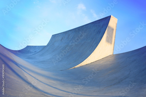 generic skatepark ramps low view to show scale with blue saturation