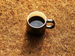Black coffee cup on brown Coconut fiber. Vintage style.Coffee lover. Wake me up