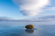 Stone on the ice of Lake Baikal