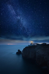 Lighthouse under starry night