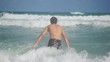 Young man going into the sea in slow motion. happy summer vacation rest relax recreation area water. 1920x1080, hd