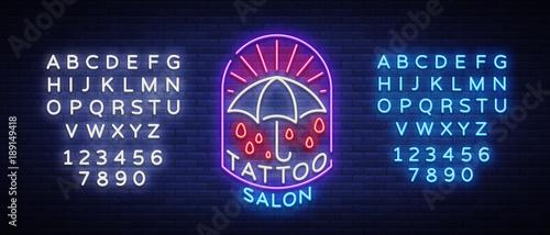 Tattoo salon logo in a neon style Wallpaper Mural