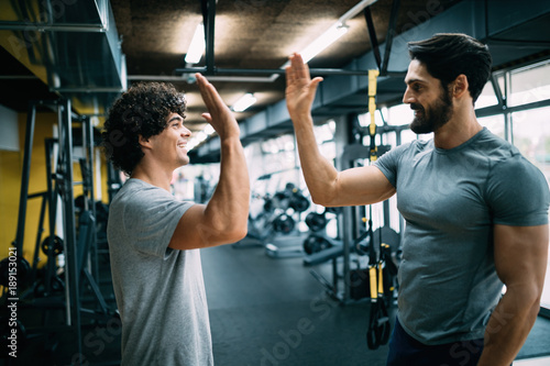 Fotografie, Tablou Man doing workout with a personal trainer.