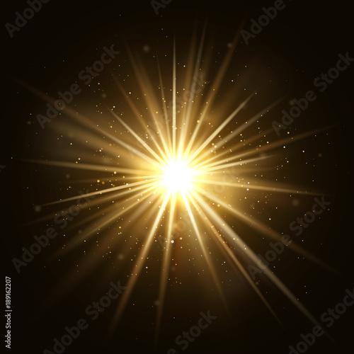 Obraz Gold star burst. Golden light explosion isolated on dark background vector illustration - fototapety do salonu
