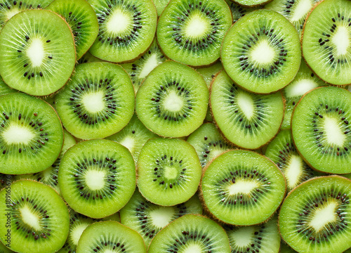 Fotobehang Macrofotografie a lot of kiwi slices as textured background