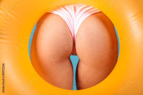 Obraz Close up of women's buttocks in swimsuit - fototapety do salonu