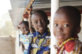 Fototapeta Łazienka - Three African Children Smiling and Laughing outdoors