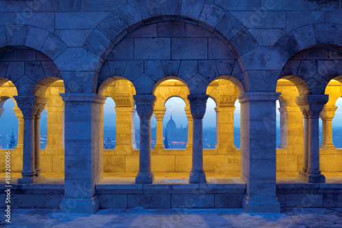 Illuminated Fishermen's Bastion arcade with Parliament dome view through arch Canvas Print
