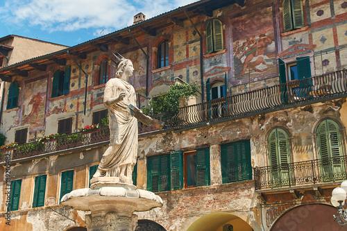 Staande foto Stockholm Ancient Statue of Fountain Madonna Verona on Piazza delle Erbe, Italy