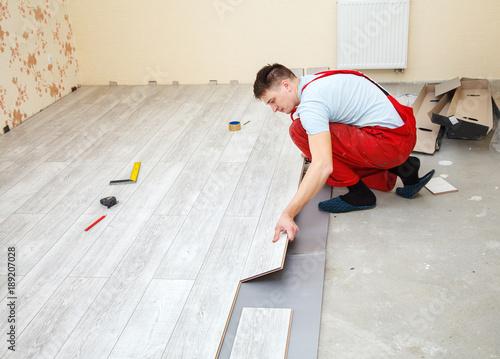 Handyman Laying Down Laminate Flooring Boards Buy This Stock Photo
