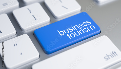 Foto  Business Tourism - Caption on Blue Keyboard Key. 3D.