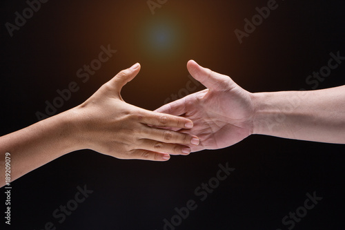 Closeup Human Hand Between Mand And Womaney Are Reaching To