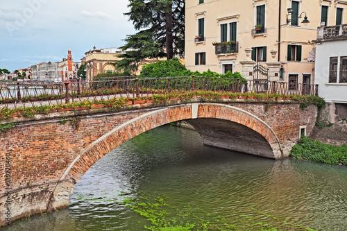 Adria, Rovigo, Veneto, Italy: ancient bridge in the old town of the city near th Wallpaper Mural
