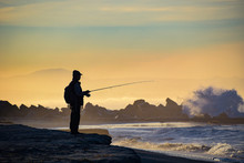 Fishing By The Pounding Surf At Coronado, California