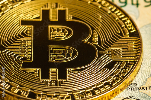 Gold bitcoin on a white background next to us paper money with a face value of d Poster