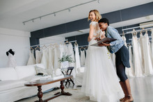 Female Trying On Wedding Gown ...
