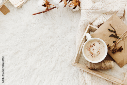 Vászonkép Winter cozy background with cup of coffee, warm sweater and old letters