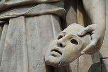 Marble Stone Sculpted Statue Holding A Dramatic Mask And Found In A Public Park During A Summer Day