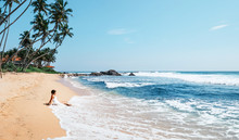 Woman Enjoy With Ocean Surf Si...