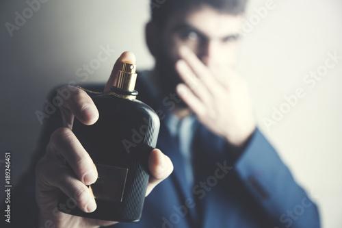 Valokuva  man hand bad odor perfume