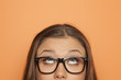 canvas print picture - half portrait of a young girl with glasses looking up