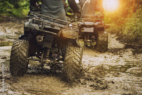 Cadres-photo bureau Motorise man riding atv vehicle on off road track ,people outdoor sport activitiies theme
