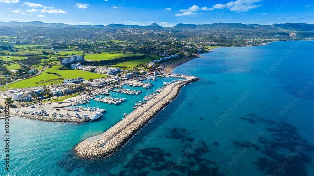 Fototapety, obrazy: Aerial bird's eye view of Latchi port,Akamas peninsula,Polis Chrysochous,Paphos,Cyprus. The Latsi harbour with boats and yachts, fish restaurant, promenade, beach tourist area and mountains from above