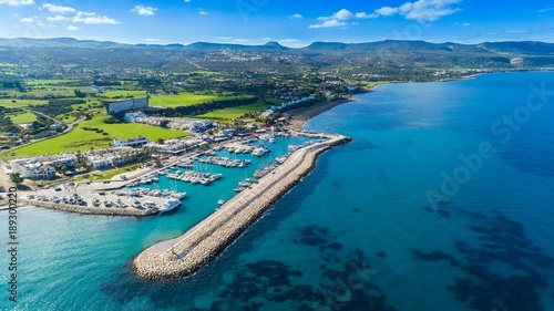 Photo sur Toile Chypre Aerial bird's eye view of Latchi port,Akamas peninsula,Polis Chrysochous,Paphos,Cyprus. The Latsi harbour with boats and yachts, fish restaurant, promenade, beach tourist area and mountains from above